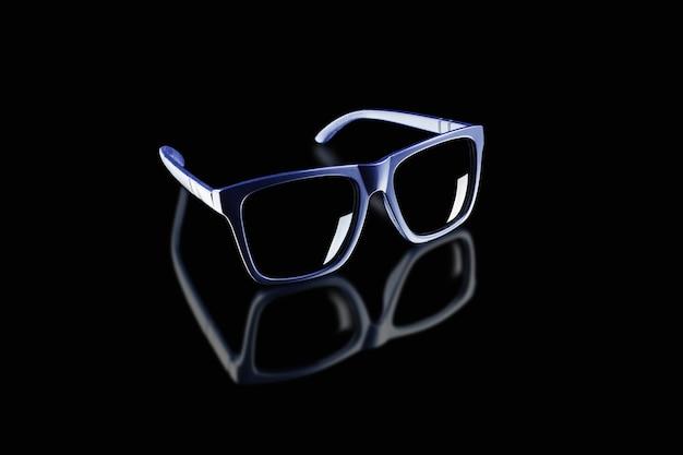 Ciemne okulary przeciwsłoneczne na czarnej odblaskowej powierzchni.