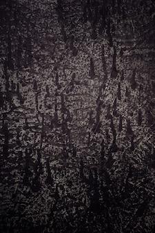 Ciemne tło lub tekstura z smugami czarnej farby.