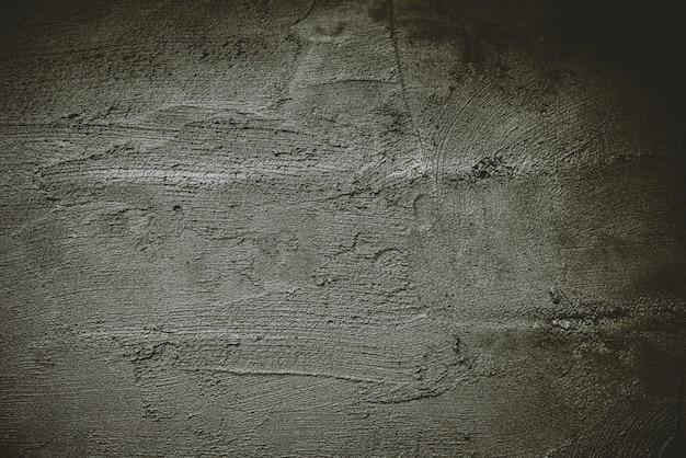 Ciemne tło, powierzchnia cementu na tle, betonowa ściana.