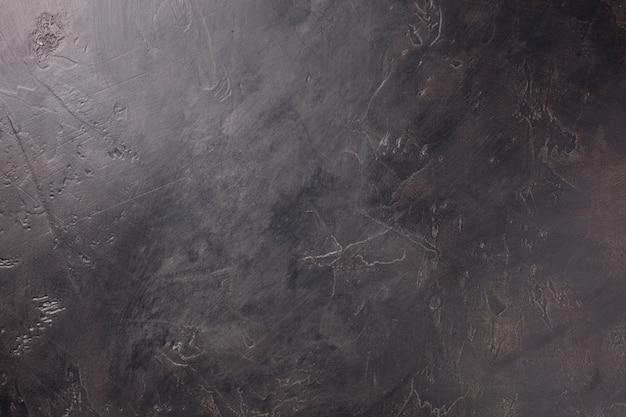 Ciemne tło ścian betonowych.