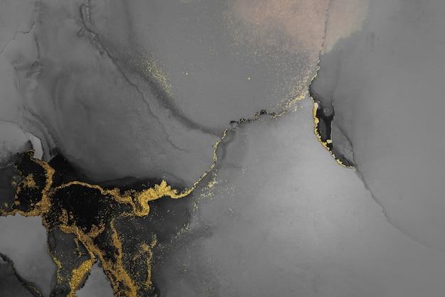 Ciemne złoto streszczenie tło marmuru płynnym tuszem sztuki malowania na papierze.