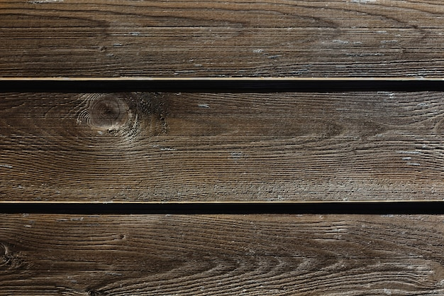 Ciemnobrązowe drewniane tło stare odrapane deski