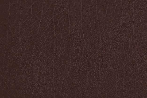 Ciemnobrązowe pogniecione skórzane teksturowane tło