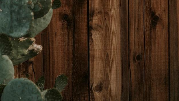 Ciemnobrązowy drewniany dom na ścianie w tle