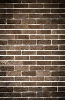 Ciemnobrązowy mur ceglany, kreatywny back-phonon, zbliżenie