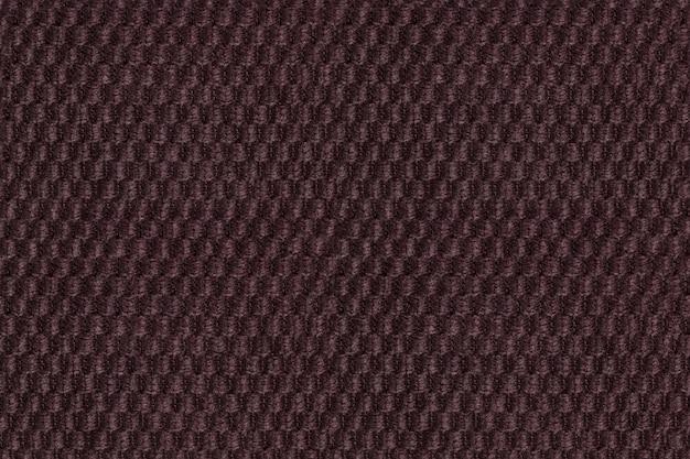 Ciemnobrązowy tło od miękkiego wełnistego tkaniny zbliżenia