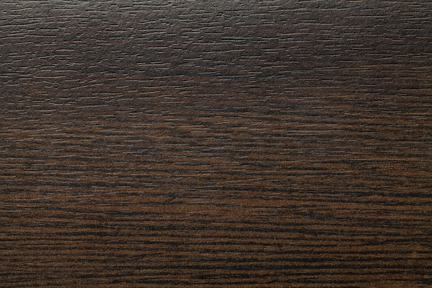 Ciemnobrązowy, wytarty laminat w stylu vintage. umbra drewniana tekstura