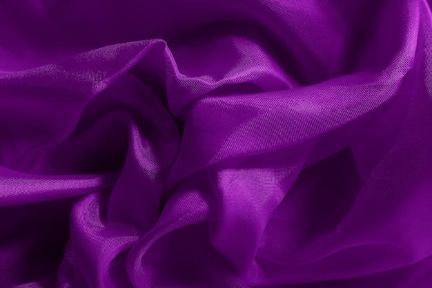 Ciemnofioletowa tkanina płótno tekstura na tle i projekt dzieła sztuki