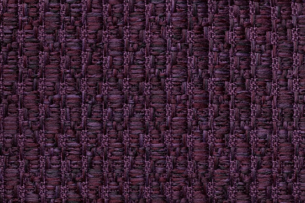Ciemnofioletowe wełniane tło z wzorem miękkiej, miękkiej tkaniny.