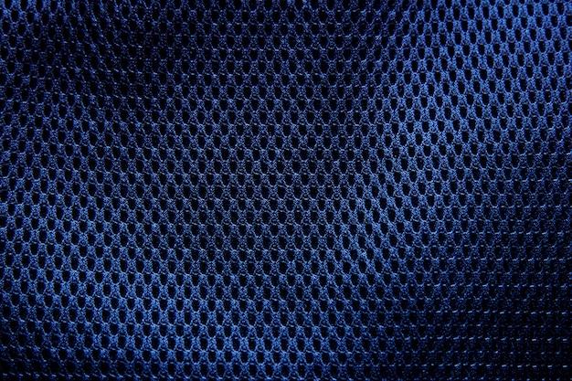 Ciemnoniebieska tekstura tkaniny z bliska.