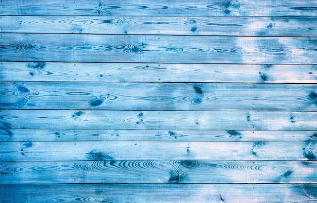 Ciemnoniebieskie deski drewniane, ułożone poziomo z pięknym tłem tekstury