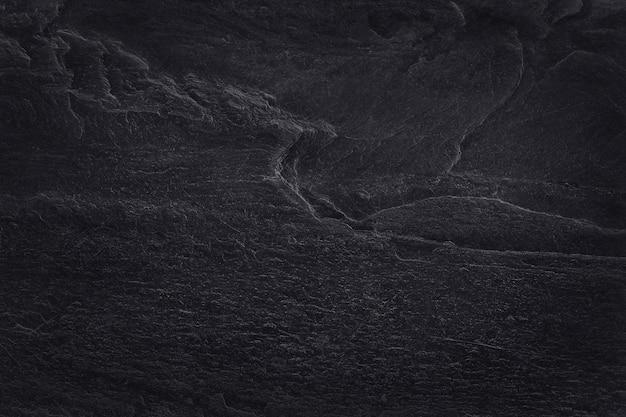 Ciemnoszara czarna tekstura łupka o wysokiej rozdzielczości, ściana z naturalnego kamienia.
