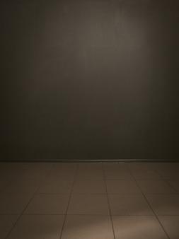 Ciemnoszary malowane ściany i płytki podłogowe tło. szablon pomysłów i kreatywności. skopiuj przestrzeń lub przestrzeń tekstową. stonowany obraz