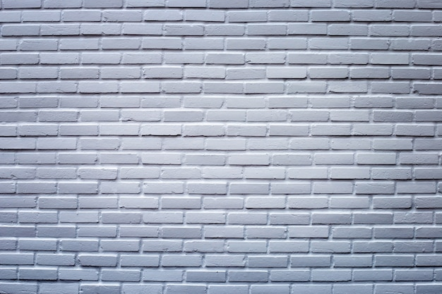 Ciemnoszary mur na tle.