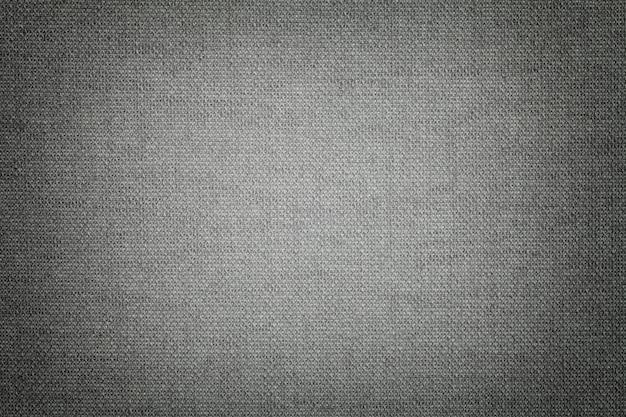 Ciemnoszary z materiału tekstylnego z wiklinowym wzorem, zbliżenie.