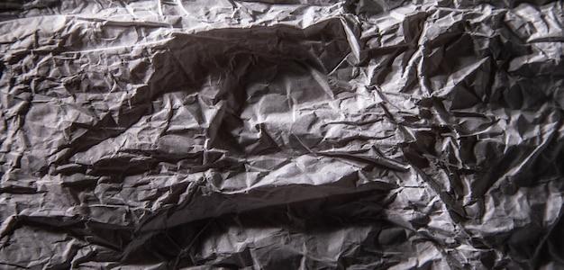 Ciemnoszary zmięty papier tekstury.