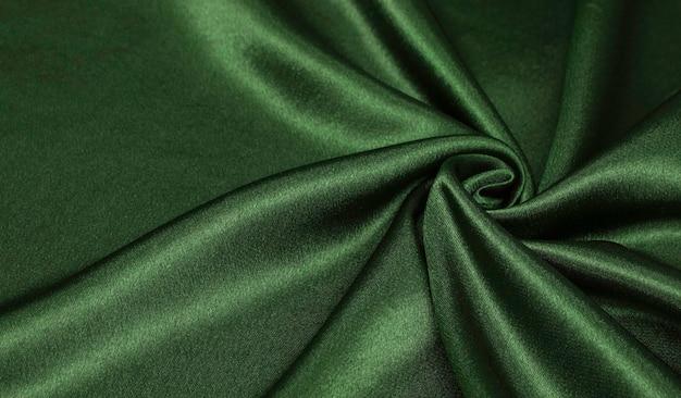 Ciemnozielona gładka elegancka zielona jedwabna lub satynowa luksusowa tekstura tkaniny