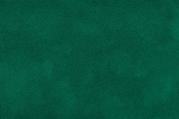 Ciemnozielona matowa zamszowa tkanina aksamitna tekstura,