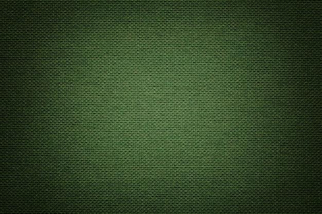 Ciemnozielony materiał tekstylny, tkanina o naturalnej fakturze.
