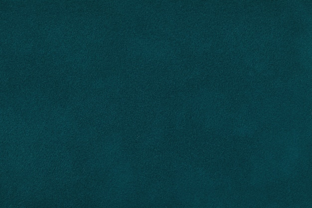 Ciemnozielony matowy zamszowy zbliżenie tkaniny. aksamitne tekstury tła.