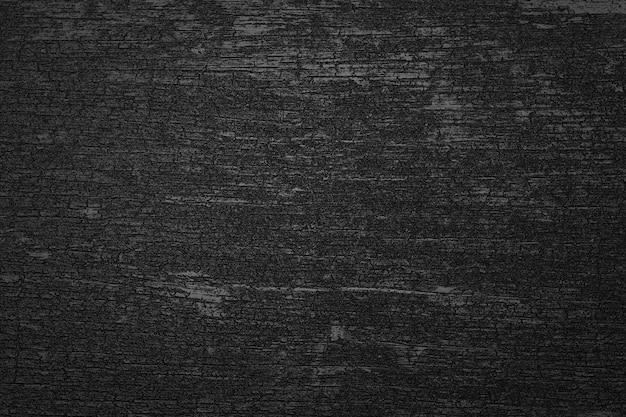 Ciemny czarny drewniany węgiel drzewny tekstura tło