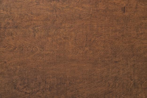 Ciemny drewniany stół tekstura, brązowe deski tło. powierzchnia drewna o wysokiej rozdzielczości