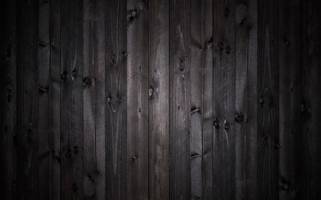 Ciemny drewniany tło, czarna tekstura
