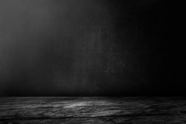 Ciemny i czarny cement ściany i studio pokoju tło