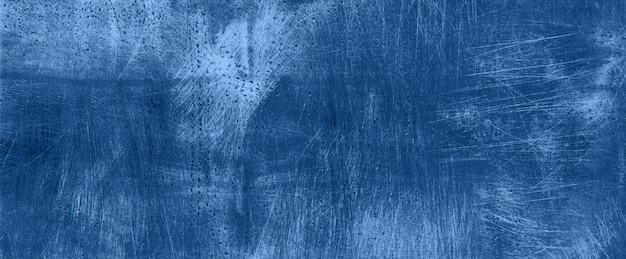Ciemny monochromatyczny cementu betonu tło. grunge tekstury, tapety. skopiuj miejsce modny niebieski i spokojny kolor. betonowa tekstura, kamienny grunt