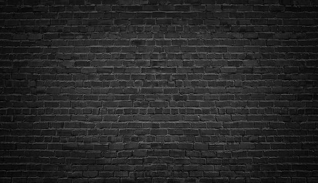Ciemny mur z cegły jako tło.