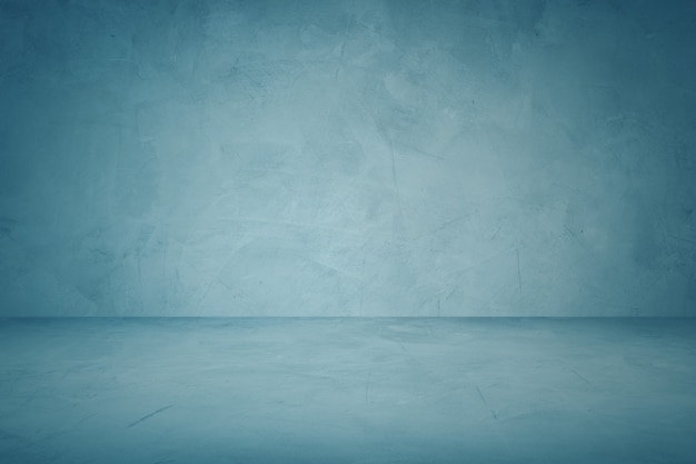 Ciemny niebieski cementowe ściany i tło rocznika studio tło