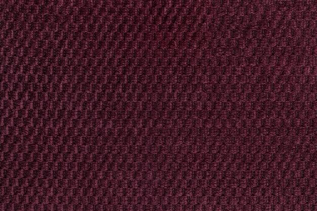 Ciemny purpurowy tło od miękkiego wełnistego tkaniny zbliżenia. tekstura włókienniczych makro