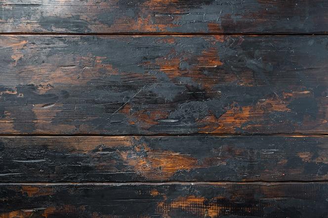 Ciemny stary drewniany stół pusty tekstura tło