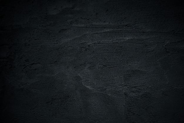 Ciemny tło, czarna cement powierzchnia dla tła, betonowa ściana.