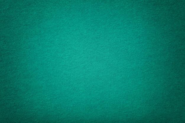 Ciemny turkusowy matowy zamsz zbliżenie tkaniny. aksamitna faktura filcu.