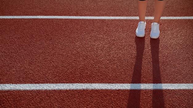 Cień z nóg na czerwonym korcie. zbliżenie na kobiece biegaczki w czarnych legginsach i trampkach w spędzających poranny czas na lokalnym stadionie. kobiecy model sportowy. pojęcie aktywności sportowej.