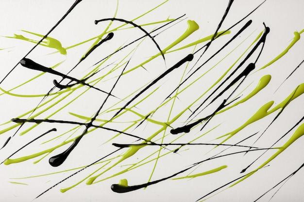 Cienkie zielono-czarne linie i plamy narysowane na białym tle
