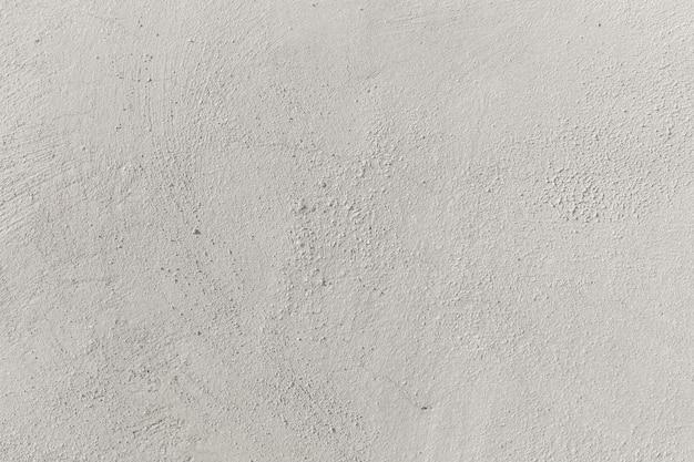 Ciepła betonowa pusta ściana tekstury lub tła