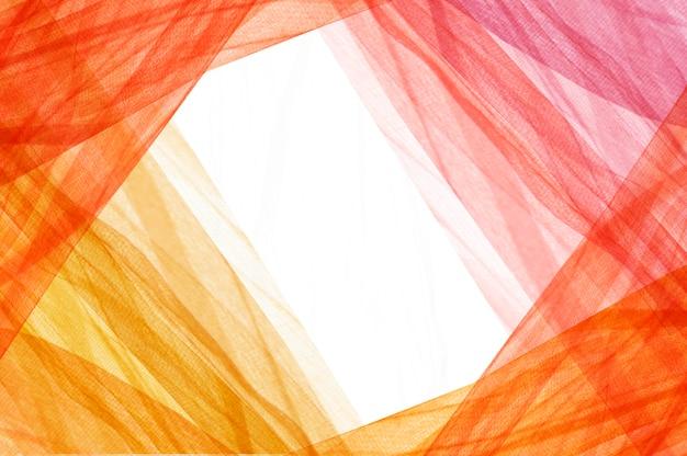 Ciepłe kolorowe tkaniny tworzące ramę