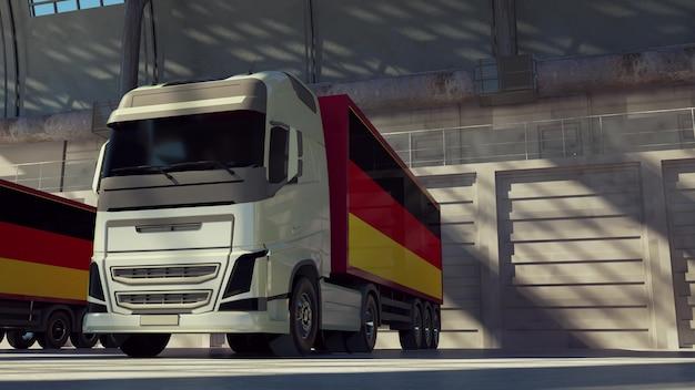 Ciężarówki cargo z flagą niemiec. samochody ciężarowe z niemiec załadunek lub rozładunek w doku magazynowym. renderowania 3d.