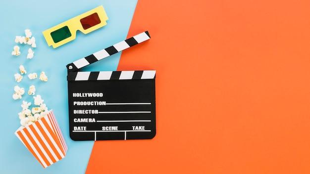 Clapperboard z okularami 3d i popcornem