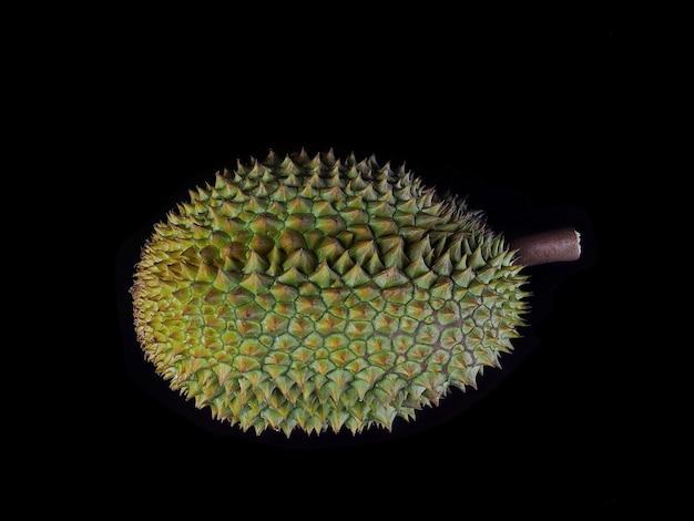 Close-up, durain mon thong, król owoców na czarnym tle.