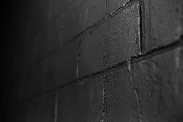 Close-up streszczenie tło teksturowanej czarny mur z cegły. ciemne zdjęcie.