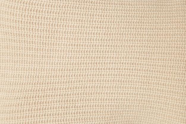 Close-up tekstura beżowa tkanina z dzianiny wełnianej