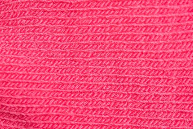 Close-up z dzianiny różowej wełny tekstury