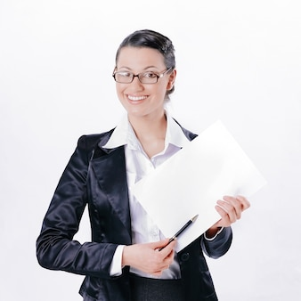 Closeup.friendly biznesowa kobieta pokazuje ołówkiem na pustym prześcieradle.