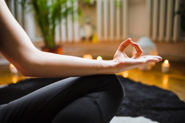 Crop hand of meditating woman