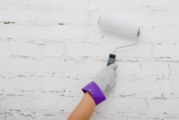 Crop hand painting wall