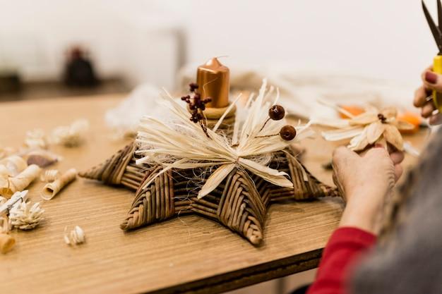 Crop woman crafting decoration