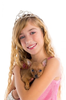 Crown princess blond girl with puppy chihuahua